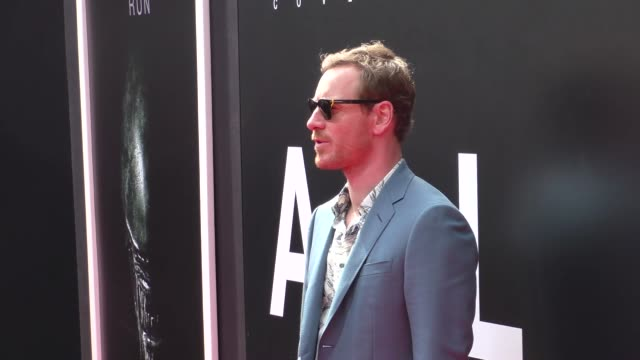michael fassbender at the sir ridley scott puts handprints-footprints in cement at tcl chinese theatre at tcl chinese theatre imax on may 17, 2017 in... - リドリー・スコット点の映像素材/bロール
