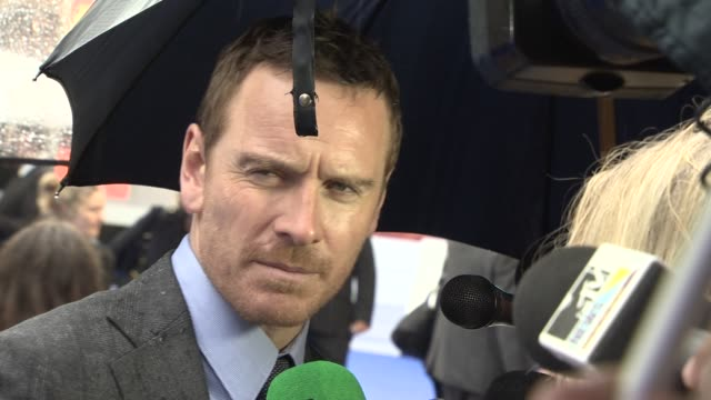interview michael fassbender on working with bryan singer and studying sir ian mckellen at 'xmen' premiere at odeon leicester square on may 12 2014... - ian mckellen stock videos and b-roll footage
