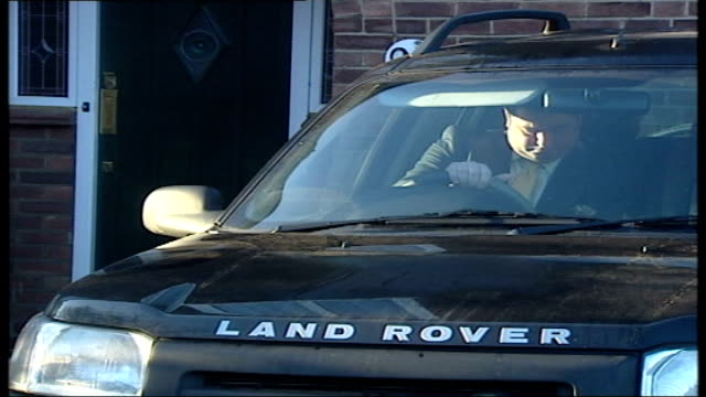 michael fawcett away in land rover england london hampton hill ext michael fawcett sitting in land rover car as drives out from house turns into road... - michael fawcett stock videos and b-roll footage