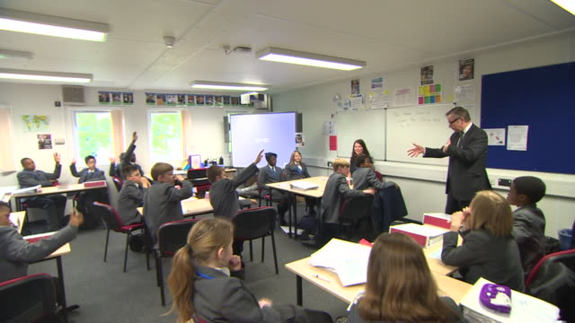 michael gove addressing students in school classroom - michael gove stock-videos und b-roll-filmmaterial