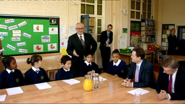 michael gove and nick clegg visit primary school in stockwell nick clegg mp and michael gove mp entering another classroom and sitting around table... - 2010 stock videos & royalty-free footage