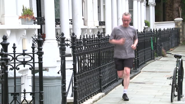 michael gove, conservative leadership contender, running down london street towards his house - running stock videos & royalty-free footage