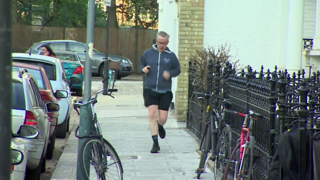 michael gove returning to his house after a run - michael gove stock-videos und b-roll-filmmaterial