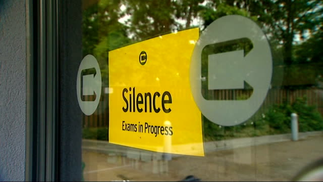 michael gove sets out gcse reforms 'silence exams in progress' sign in examination room window - 一般教育証明試験点の映像素材/bロール
