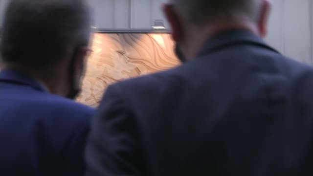 michael gove tours ulster carpets; northern ireland: county armagh: portadown: int various shots large framed carpet of lion and michael gove mp... - county armagh stock videos & royalty-free footage
