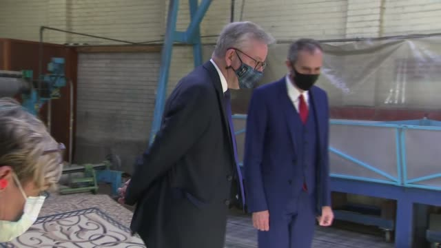 michael gove tours ulster carpets ***flash county armagh portadown int various shots michael gove mp along towards with factory staff as looking at... - differential focus stock videos & royalty-free footage