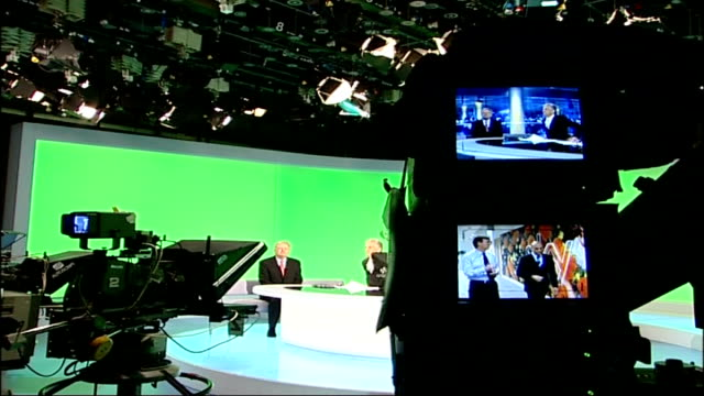 michael grade switches from bbc to become itv executive chairman; gir: int itv news studio as grade is interviewed on lunchtime news monitor showing... - bbc stock videos & royalty-free footage