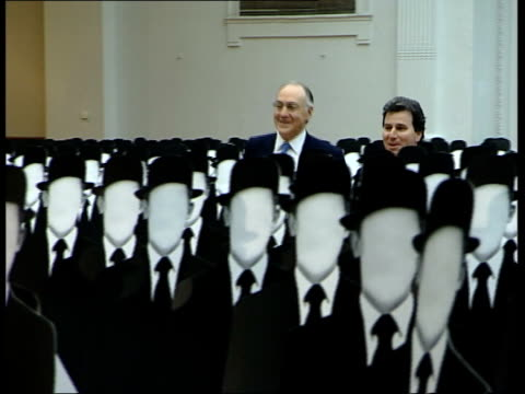 michael howard tory leadership 100 days old lib howard along chatting to oliver letwin mp past 511 cardboard cutouts to show the number of civil... - domestic staff stock videos & royalty-free footage