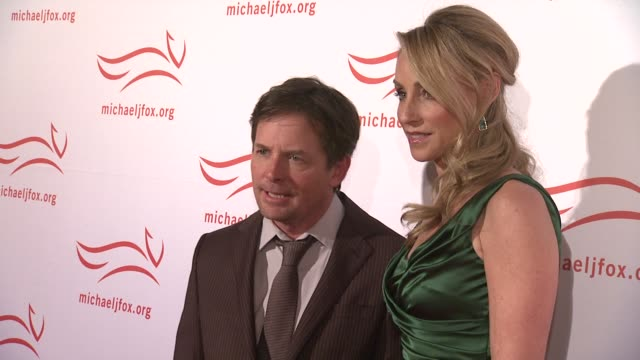michael j fox and tracy pollan at the 2011 a funny thing happened on the way to cure parkinson's red carpet at new york ny - michael j. fox stock videos and b-roll footage
