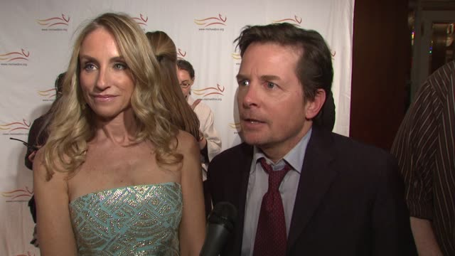 Michael J Fox and Tracy Pollan talking about how he stays positive Tracy being the realist why they chose to get out and help others and their...