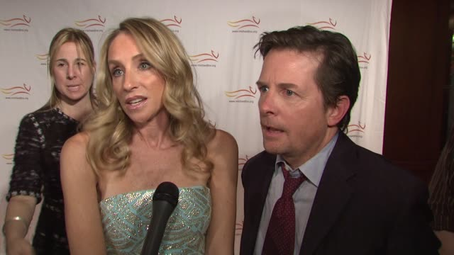 Michael J Fox and Tracy Pollan talking about how why they chose to get out and help others at the 'A Funny Thing Happened On The Way To Cure...