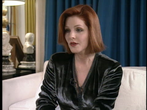 michael jackson and lisa marie presley deplane as lisa's mother priscilla presley discusses the impromptu marriage in 1994. - lisa marie presley stock videos & royalty-free footage