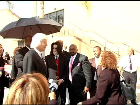 Michael Jackson and Thomas Mesereau Jr at the Funeral of Johnnie L Cochran Jr Arrivals at West Angeles Cathedral in Los Angeles California on April 6...