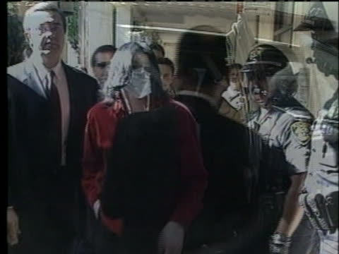 michael jackson carries an umbrella and waves to fans. - stil der 2000er jahre stock-videos und b-roll-filmmaterial