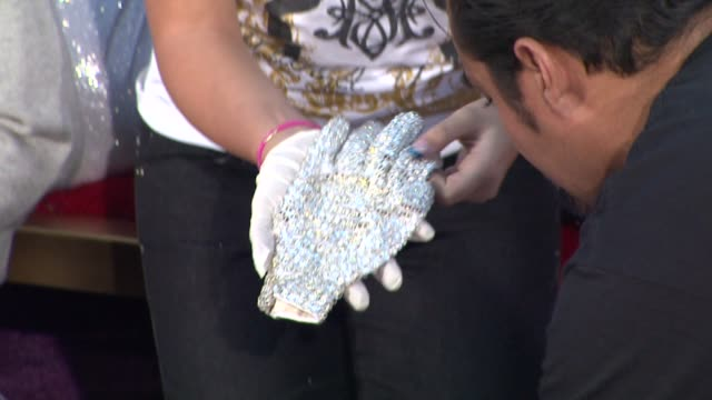 michael jackson glove at michael jackson immortalized with hand and footprint ceremony in hollywood ca on 1/26/2012 - michael jackson stock videos and b-roll footage