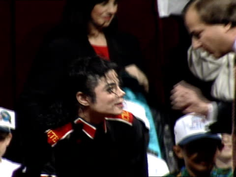 michael jackson group of children on stage jackson speaking w/ male sitting down w/ children zo to ws silhouette of press lower fg hbo - super bowl stock videos & royalty-free footage