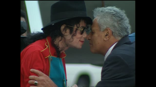michael jackson in 1996 arriving at auckland airport and presented with māori greenstone pendant by entertainer sir howard morrison and traditional... - pendant stock videos & royalty-free footage
