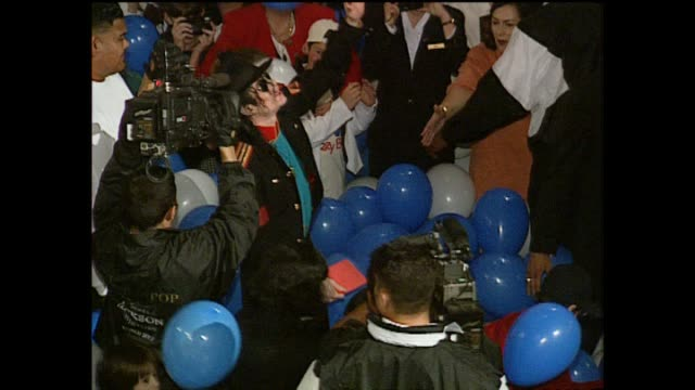 michael jackson in 1996 tossing balloons into the air as they fall on group of children following māori powhiri at carlton hotel - māori people stock videos & royalty-free footage