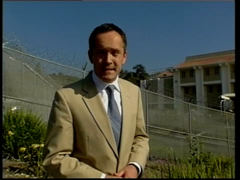 police expect to make arrest soon itn press gathered at perimeter fence of jail pan i/c black limousine along thru gate as transporting jackson from... - limousine stock-videos und b-roll-filmmaterial