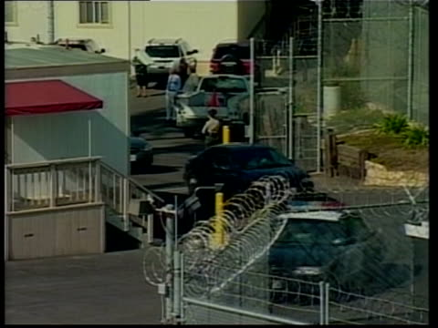 police expect to make arrest soon itn usa california santa barbara convoy of cars along thru jail compound as singer michael jackson transported to... - santa barbara california stock videos & royalty-free footage