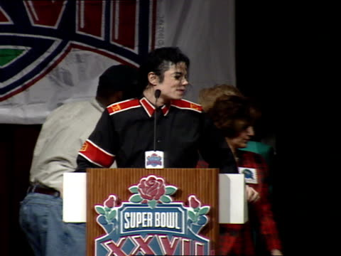 michael jackson standing on stage saying thank you to everyone i love you stepping aside from podium - super bowl stock videos & royalty-free footage