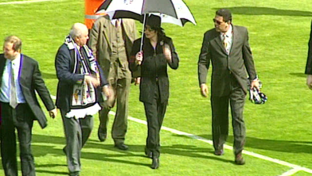 Michael Jackson statue at Fulham FC TX High anghe view of Michael Jackson walking across Fulham FC football pitch at Craven Cottage with Mohamed...
