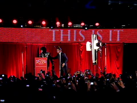 Michael Jackson walks onstage at the Michael Jackson This Is It Performances Announcement at London
