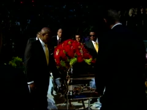 michael jackson's glittering, gold-plated casket was placed at the front of the stage at a public memorial here tuesday as a gospel choir sang. we... - coffin stock videos & royalty-free footage