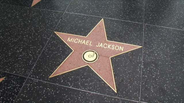 cu tu ws michael jackson's star and hollywood boulevard / los angeles, california, usa - ウォークオブフェーム点の映像素材/bロール