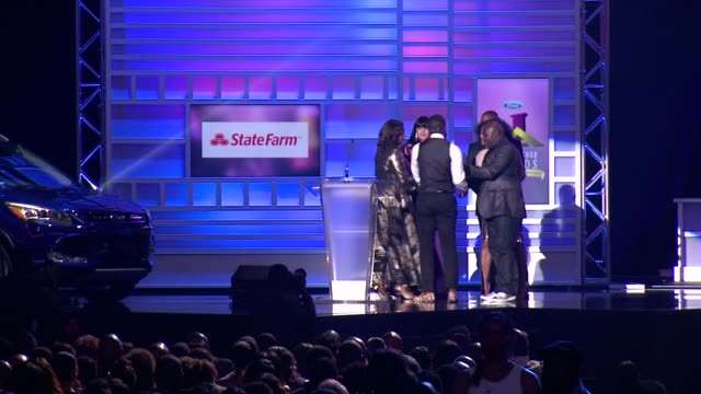 SPEECH Michael Jai White Tracee Ellis Ross David Mann presents the best high school category award at 2014 Ford Neighborhood Awards Hosted By Steve...