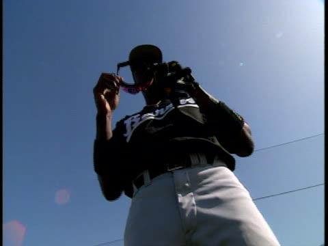 michael jordan takes off his sunglasses while wearing a baseball uniform - baseball uniform stock videos & royalty-free footage