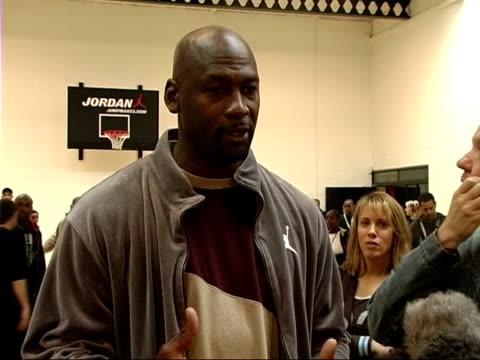 michael jordan visits lambeth college michael jordan speaking to press sot how he got into basketball/ europeans getting better at basketball/ up and... - kobe bryant stock videos & royalty-free footage