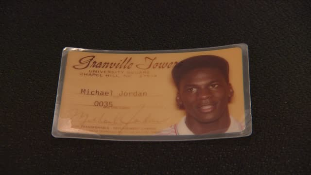 michael jordan's signed north carolina granville towers i.d. at the gotta have rock and roll's the rock & roll pop culture auction michael jackson's... - ネバーランドバレーランチ点の映像素材/bロール