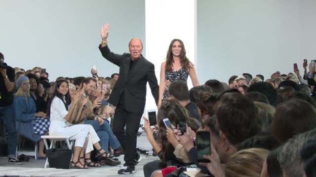 Michael Kors and Sara Bareilles the runway at Michael Kors Collection New York Fashion Week Spring 2018 at Spring Studio on September 12 2017 in New...