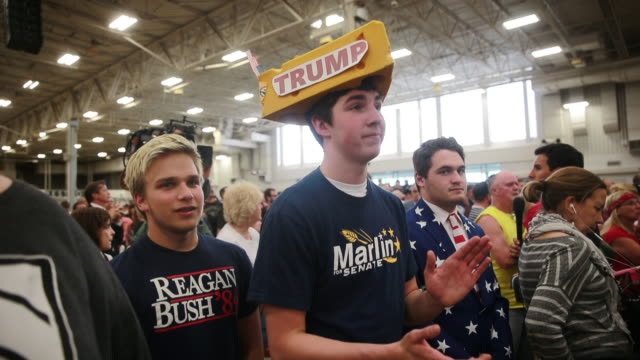 michael kuzma wears a homemade donald trump hat during the singing of the national anthem for a rally for donald trump at the indiana state... - hat stock videos & royalty-free footage