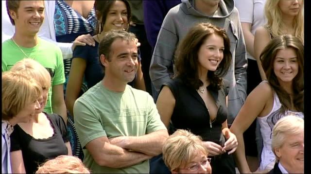 michael le vell charged with sex offences file / location unknown ext michael le vell posing for photocall with others - マイケル レ ベル点の映像素材/bロール