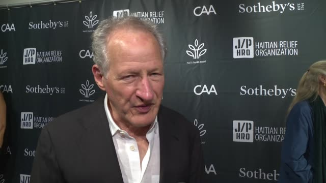 interview – michael mann on why he's here tonight sean penn's efforts in haitiat sean penn friends haiti takes root benefit dinner auction supporting... - サザビーズ点の映像素材/bロール
