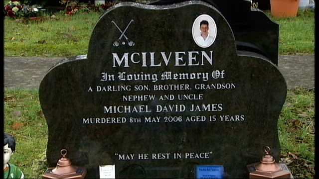 four men given life sentences northern ireland county antrim ballymena ext general views and close shots of the grave of michael mcilveen relatives... - rosary beads stock videos & royalty-free footage