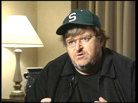Michael Moore interview SOT Talks of feeling of fear he says is generated by the Bush administration TMS Moore giving interview