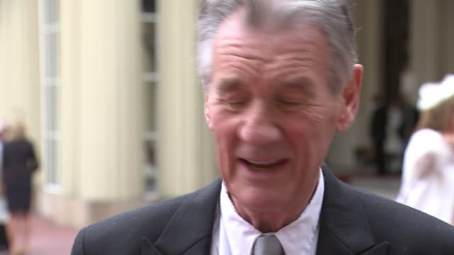michael palin knighted at buckingham palace ceremony; england: london: buckingham palace: ext sir michael palin interview sot - being knighted is... - マイケル パリン点の映像素材/bロール
