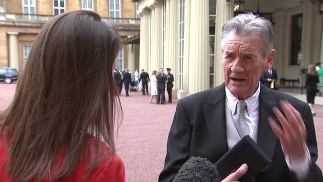 michael palin knighted at buckingham palace ceremony; england: london: buckingham palace: ext sir michael palin interview sot - re early days of... - モンティ・パイソン点の映像素材/bロール