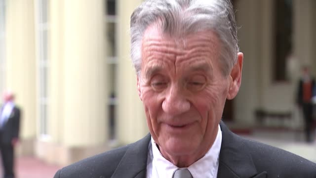 michael palin knighted at buckingham palace ceremony; england: london: buckingham palace: ext sir michael palin interview sot - re being knighted - マイケル パリン点の映像素材/bロール