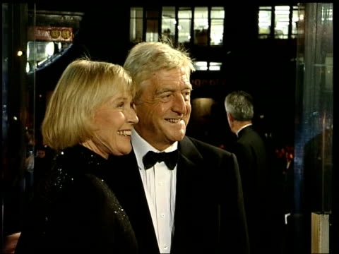 stockvideo's en b-roll-footage met michael parkinson moves to itv lib london photography*** / michael parkinson posing for photo opportunity at national tv awards ceremony with wife... - michael parkinson