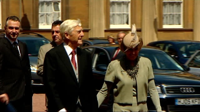 stockvideo's en b-roll-footage met michael parkinson receives knighthood parkinson towards with his wife mary heneghan reporter to camera cutaways press close up of sir michael sir... - michael parkinson