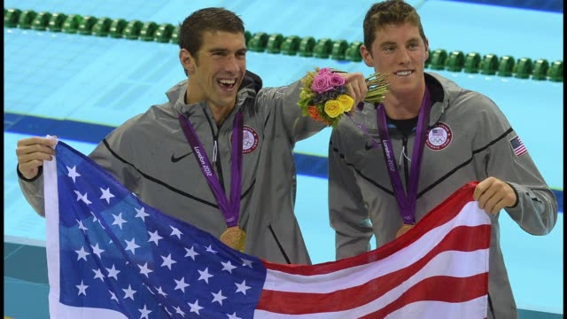 michael phelps becomes the most decorated olympian of all time winning a record 19th medal in the pool to overhaul the record of soviet gymnast... - medal stock videos & royalty-free footage