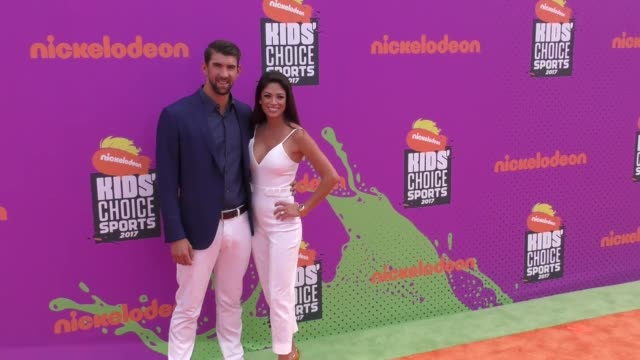 Michael Phelps Nicole Johnson at the Nickelodeon Kids' Choice Sports Awards 2017 at UCLA's Pauley Pavilion on July 13 2017 in Westwood California