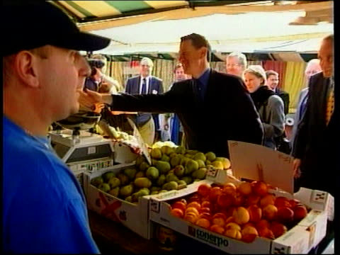 michael portillo hits the campaign trail itn northamptonshire michael portillo along campaigning in wellingborough and rushden and shaking hands with... - northamptonshire stock videos and b-roll footage