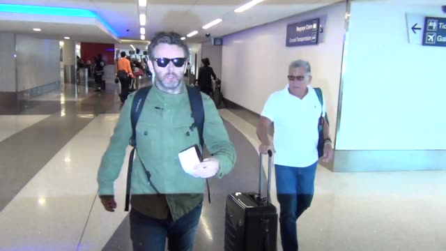 michael sheen at lax airport on october 08, 2015 in los angeles, california. - michael sheen bildbanksvideor och videomaterial från bakom kulisserna