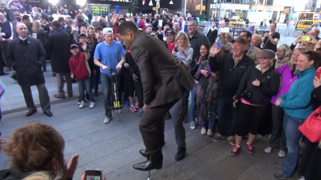 michael strahan tries to pogo outside the set of the 'good morning america' show in celebrity sightings in new york - good morning america stock videos and b-roll footage