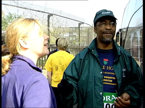 michael watson finishes epic walk; itn england: london: ext former boxer michael watson, who suffered brain damage during a fight with chris eubank,... - chris eubank sr. stock videos & royalty-free footage